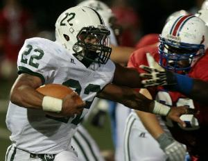 Dante Tobler of New Milford carries the ball as Kyle Nelson of Secaucus tries to tackle him.