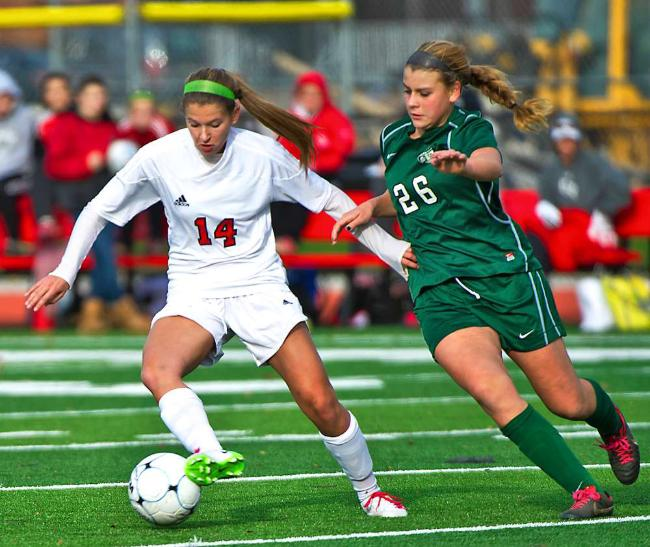 Glen Rock's Hannah Petrone, left, keeps the ball away from Kinnelon's Ida DiClemente in the North 1, Group 2 state semifinals. Petrone's overtime goal gave the Panthers a 2-1 victory.